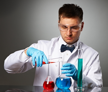 Scientist in protective glasses at laboratory Stock Photo - 23327322