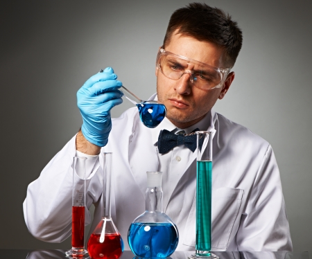 Scientist in protective glasses at laboratory Stock Photo - 23455537