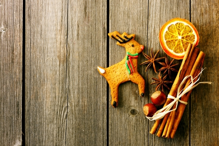 Christmas homemade gingerbread deer over wooden table photo