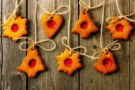 Christmas homemade gingerbread cookies over wooden table Stock Photo - 23699165