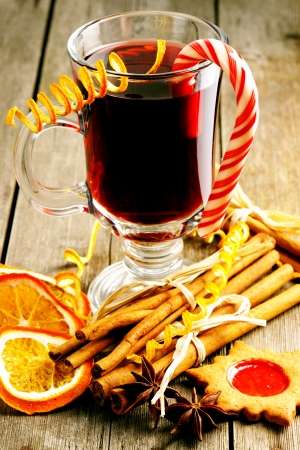 Glass of red mulled wine on wooden table Stock Photo - 23997310
