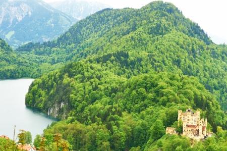 schwangau: Landscape with castle of Hohenschwangau in Bavaria, Germany. Stock Photo