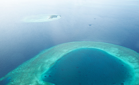 Group of atolls and islands in Maldives from aerial view Stock Photo - 25622081