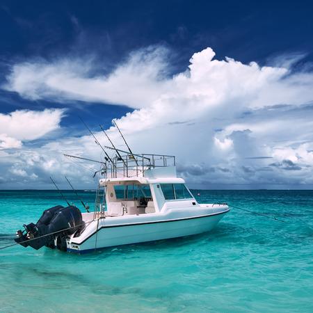 motor boats: Beautiful island beach with motor boat at Maldives