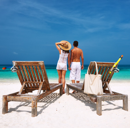 Couple in white on a tropical beach at Maldives photo