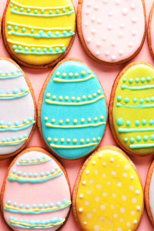 Easter homemade gingerbread cookie over pink photo