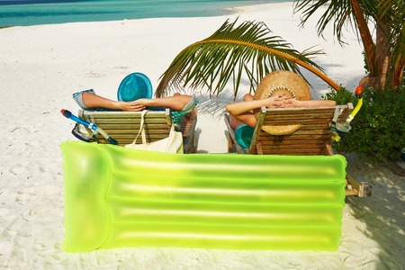 sea bed: Couple in green on a tropical beach at Maldives
