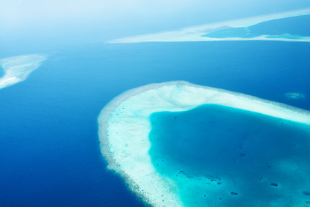 Group of atolls and islands in Maldives from aerial view Stock Photo - 26380400