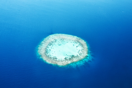 Group of atolls and islands in Maldives from aerial view Stock Photo - 26380401