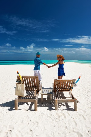 Couple in blue on a tropical beach at Maldives photo