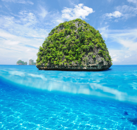 Beautiful uninhabited island in Thailand with white sand bottom underwater and above water split view Stock Photo - 26611874