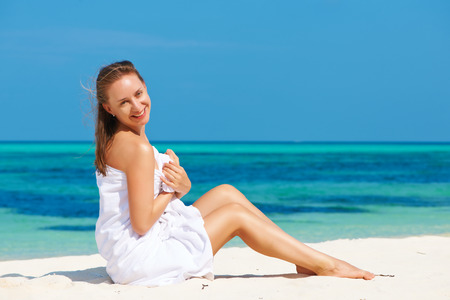Woman in towel at tropical beach photo