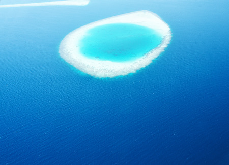 Group of atolls and islands in Maldives from aerial view Stock Photo - 26611904
