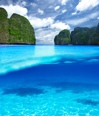 sea scenery: Beautiful lagoon at  Phi Phi Ley island with white sand bottom underwater and above water split view