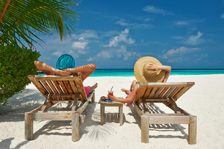 chairs: Couple on a tropical beach at Maldives