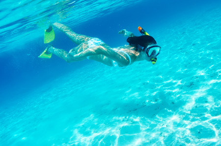 Woman with mask snorkeling in clear water Stock Photo - 26770616