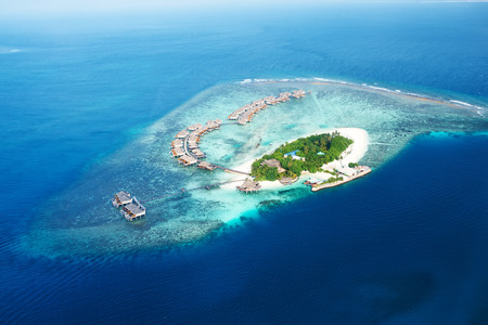 Group of atolls and islands in Maldives from aerial view photo