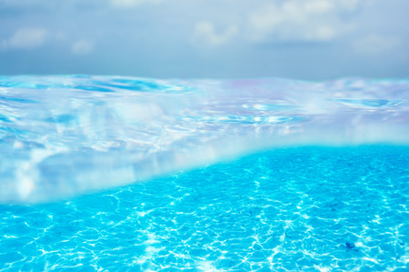 A white sand bottom in clear water at Maldives photo