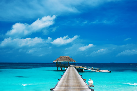 wooden dock: Beautiful beach with water bungalows at Maldives Stock Photo