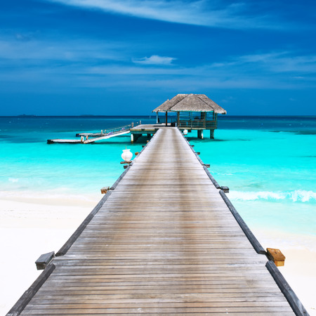 Beautiful beach with water bungalows at Maldives photo