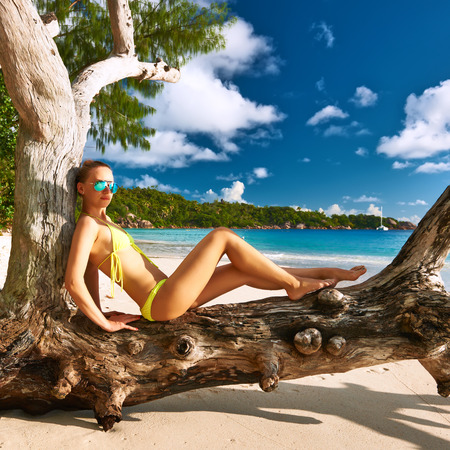 sexy girl sitting: Woman in bikini at tropical beach at Seychelles Stock Photo