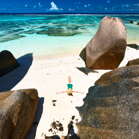 Woman at beautiful beach at Seychelles photo