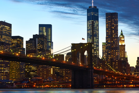 Brooklyn Bridge with lower Manhattan skyline in New York City at evening photo
