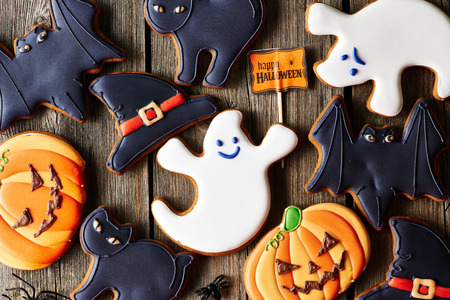 jack o lantern: Halloween homemade gingerbread cookies over wooden table Stock Photo