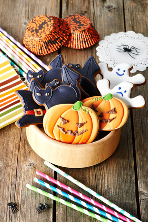 Halloween homemade gingerbread cookies over wooden table photo