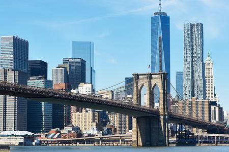 Brooklyn Bridge with lower Manhattan skyline in New York City photo