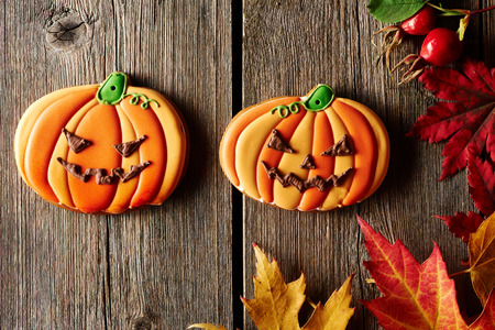 Halloween homemade gingerbread cookie over wooden background photo