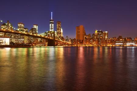 Brooklyn Bridge with lower Manhattan skyline in New York City at night photo