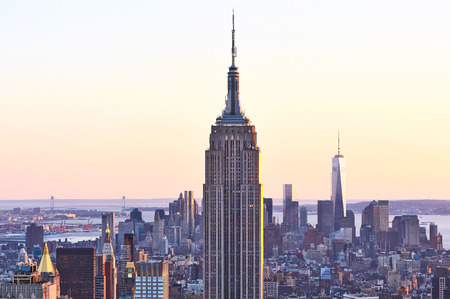 Cityscape view of Manhattan with Empire State Building, New York City, USA at sunset
