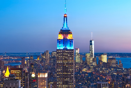 Cityscape view of Manhattan with Empire State Building, New York City, USA at night Редакционное