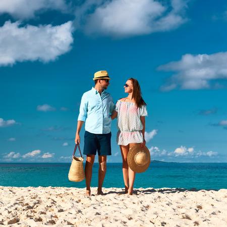 Couple on a tropical beach at Seychelles photo
