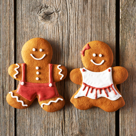 Christmas homemade gingerbread couple cookies on wooden table photo