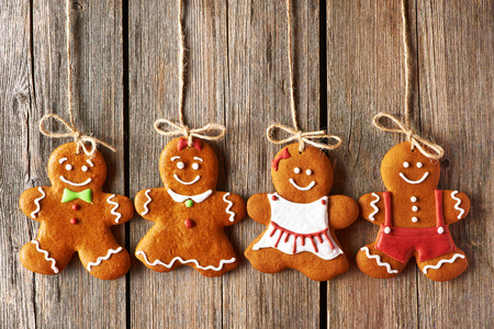 Christmas homemade gingerbread couple cookies over wooden background photo
