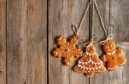 gingerbread man: Christmas homemade gingerbread cookies over wooden background Stock Photo