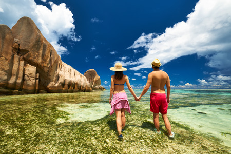Couple on a tropical beach at Seychelles photo