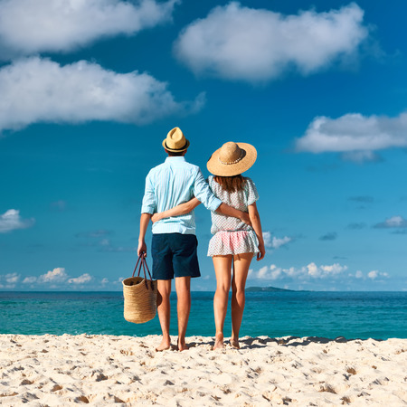 back to back couple: Couple on a tropical beach at Seychelles