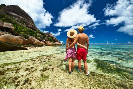 seychelles: Couple on a tropical beach at Seychelles