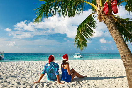 Couple in blue clothes on a tropical beach at christmas photo