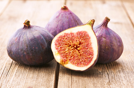purple fig: Fresh figs on rustic vintage wooden table