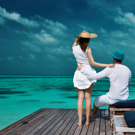 couple nature: Couple on a tropical beach jetty at Maldives Stock Photo