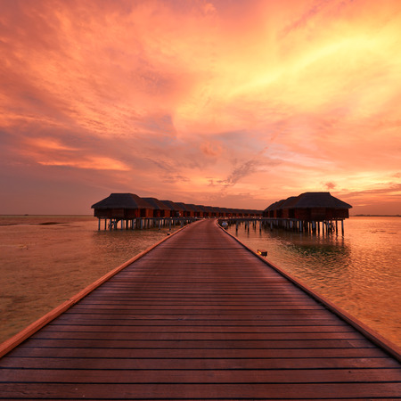 Beautiful sunset at Maldivian beach photo
