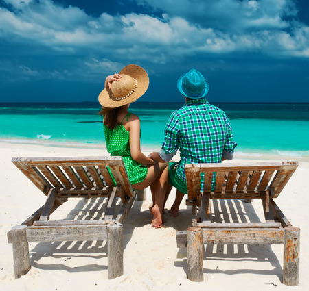 Couple in green on a tropical beach at Maldives photo
