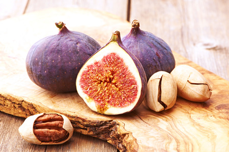 pecan: Fresh figs on rustic vintage wooden table
