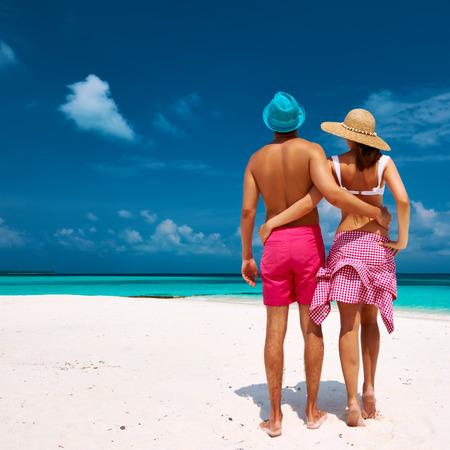 Couple on a tropical beach at Maldives photo