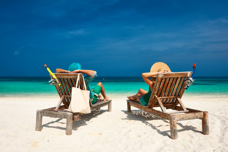 relax beach: Couple in green relax on a tropical beach at Maldives Stock Photo