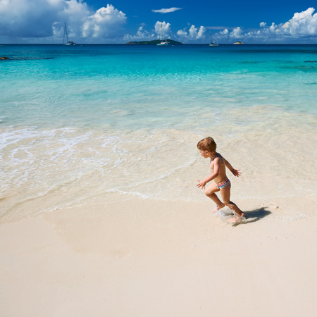 two year: Two year old baby boy playing on beach at Seychelles
